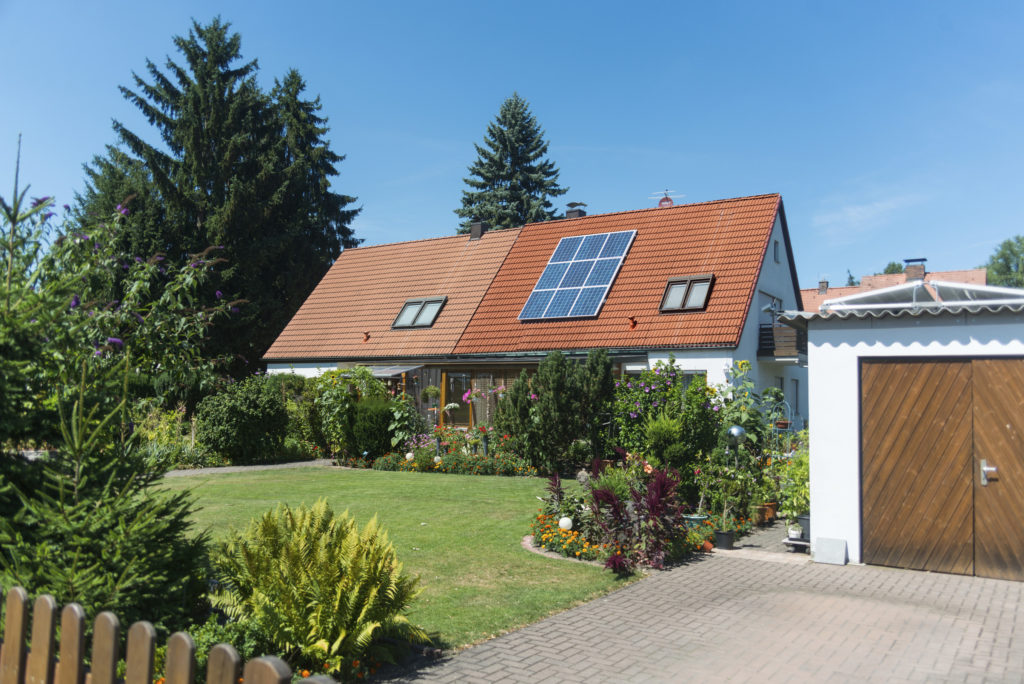 Nuremberg, Germany - July 26, 2015: house with solar panels. Blue sky and no person visible. house is standing in nuremberg east.